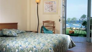 GRECOTEL Lakopetra Beach Bungalowzimmer mit Balkon und Meerblick