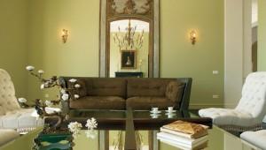 GRECOTEL Mandola Rosa Suites und Villas Loungebereich mit Sesseln