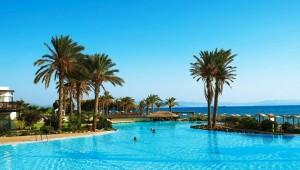 GRECOTEL Kos Imperial Thalasso Pool mit Palmen und direktem Meerblick