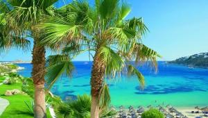 GRECOTEL Mykonos Blu Palmengarten auf dem hang mit Blick auf das Meer
