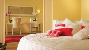 GRECOTEL Mandola Rosa Suites und Villas Presidential Beach Schlafzimmer