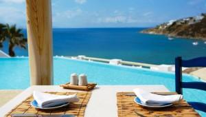 GRECOTEL Mykonos Blu L'Archipel Restaurant direkt am Pool und mit Meerblick