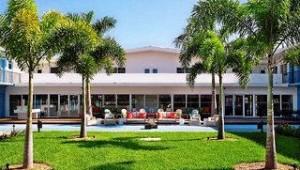 Florida Rundreise Postcard Inn on the Beach mit wunderschöner Gartenanlage